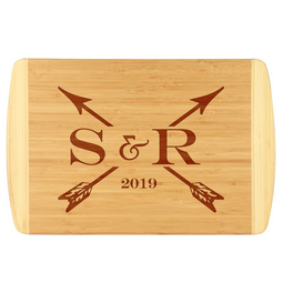 Initials & arrows custom bamboo cutting board is laser engraved with custom initials and established year.  Uniquely designed custom cutting board.