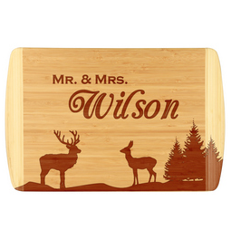 Unique buck, doe and tree bamboo cutting board.  Customize with your last name.  Laser engraved for detailed look and quality.